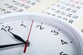 Sheet of a calendar with clockface — Stock Photo