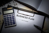 Business still life with business plan — Stockfoto