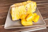 Jackfruit  on a plate on a wooden table — Stock Photo
