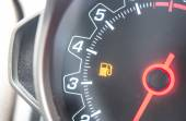Out Of Gas - A car's gas tank is nearly empty. — Stock Photo