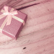 Vintage gift box on wooden background — Stock Photo #56965849