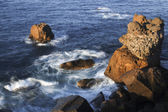 Ocean swirling around a rocky outcrop — Stock Photo