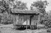 Wooden hovel, shanty, shack in Philippines in black and white — Stock Photo