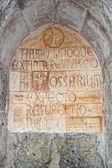 Medieval latin inscription outside italian church — Стоковое фото