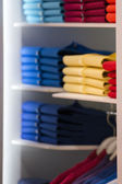 Short sleeves polo shirt on display stand — Stock fotografie