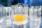 Ice blocks glasses in a ice hotel bar pub — Stock Photo