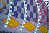 Fun Fair Carnival Luna Park moving lights background — Stock Photo