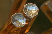 Diamanter på guldtacka — Stockfoto