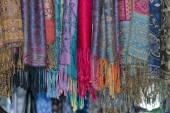 Silk pashmina on display sand for sale — Stock Photo