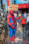 LOS ANGELES, USA - AUGUST 1, 2014 - people and movie mask on  Walk of Fame — Stock Photo