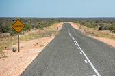 Floodway sign West Australia Desert endless road — Stock Photo
