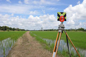 Survey instrument set on a tripod in the field — Stock Photo