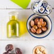 Argan nuts and oil on tabletop — Stock Photo #56703161