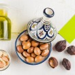 Argan nuts and oil on tabletop — Stock Photo #57299949
