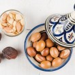 Argan Fruit on wooden tabletop — Stock Photo #57299971