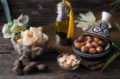 Argan oil and fruits with Shea butter and nuts — Stock Photo
