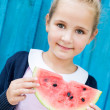 Funny child eating watermelon — Stock Photo #52878535