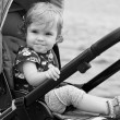 Happy baby in a stroller — Stock Photo #55325447