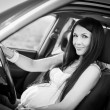 Beautiful pregnant woman driving — Stock Photo #56315211