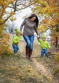 Two little brother and mother on walk — Stock Photo