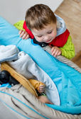 Happy Toddler brother looks at newborn — Stock Photo