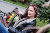Beautiful happyl woman with tulips in a bag  — Stock Photo