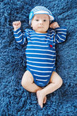 Cute newborn baby in knitted cap — Stock Photo