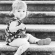 Little cute girl in sitting on the stairs — Stock Photo #71358533