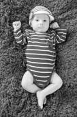 Cute newborn baby in knitted cap — Stock Photo