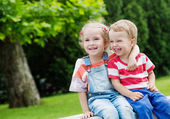 Happy Toddler brother and sister hugging — Stock Photo