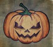 Halloween pumpkin painted on fabric. — Stock Photo