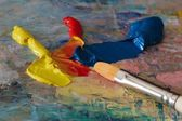 Primary oil colours and a brush — Stock Photo