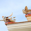 Traditional Thai style sculpture decoration on the Thai temple roof — Stock Photo #77688244