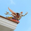Traditional Thai style sculpture decoration on the Thai temple roof — Stock Photo #77688256