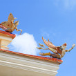 Traditional Thai style sculpture decoration on the Thai temple roof — Stock Photo #77688268