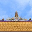 Traditional Thai style sculpture decoration on the Thai temple roof — Stock Photo #77688280