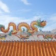 Traditional Chinese style sculpture decoration on the Thai temple roof — Stock Photo #77688686