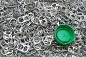 Ring pull of cans and green lid for background — Stock Photo