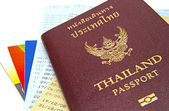 Thailand passport isolated on white background on bank account passbook background — Stock Photo