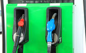 Pump nozzles in gas station — Stock Photo