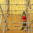 Worker working during renovation of large buddha statue at Wat Muang, Thailand. — Stock Photo #78899672