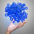 Businessman hand showing blue gears cogs to success concept — Stock Photo #55610527