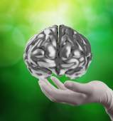 Doctor neurologist hand show metal brain with computer interface — Stock Photo