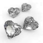 Diamond heart shape on white surface — Stock Photo