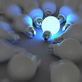 3d growing light bulb standing out from the unlit incandescent b — Stock Photo