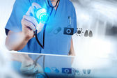 Medicine doctor hand working with modern computer interface as m — Stock Photo