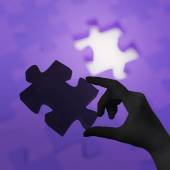 Female hand placing last piece of Puzzle as concept — Stock Photo