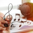 Close up of Hand drawing musical notes on screen as music compos — Stock Photo #66137721
