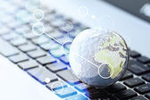 Hand drawn texture globe with blank social media diagram on lapt — Stock Photo