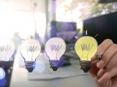 Businessman hand drawing creative business strategy with light b — Stock Photo